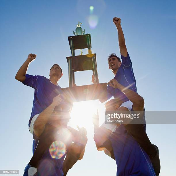 Football players holding trophy
