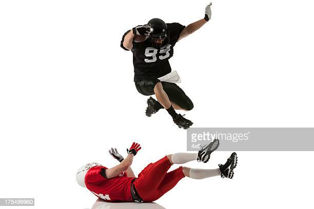 football players in action - tackle american football player stock pictures, royalty-free photos & images