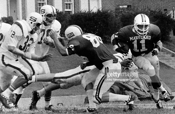 Football players including Art Seymour during a game with University of Maryland football team Baltimore Maryland 1980