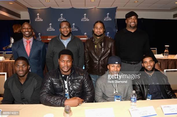 Football players Jason Avant, Terrence Stephens, Josh Cribbs, Keith Hamilton, Victor Aiyewa, Bryant McKinnie, Trent Shelton, and Quintin Demps attend...