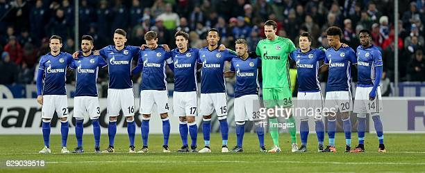 Football players lineup for a minute of silence in memory of the members of the Brazillian soccer team Chapecoense who died in a plane crash before...