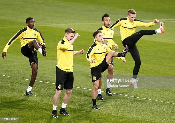 Football players of Borussia Dortmund attend a training session ahead of the UEFA Champions League group F soccer match between Real Madrid and...