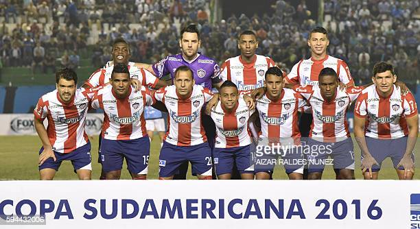Football players of Colombia's Junior pose for pictures before their Copa Sudamericana 2016 football match against Bolivia's Blooming at the Ramon...