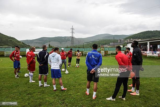Football players of FC Hajvalia warm up during a training session near Kishnica in the district of Pristina on May 12 2016 With 141 votes in favour...