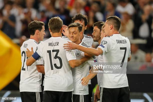 Football players of Germany celebrate after scoring a goal during the FIFA 2018 World Cup Qualifier between Germany and Norway at MercedesBenz Arena...