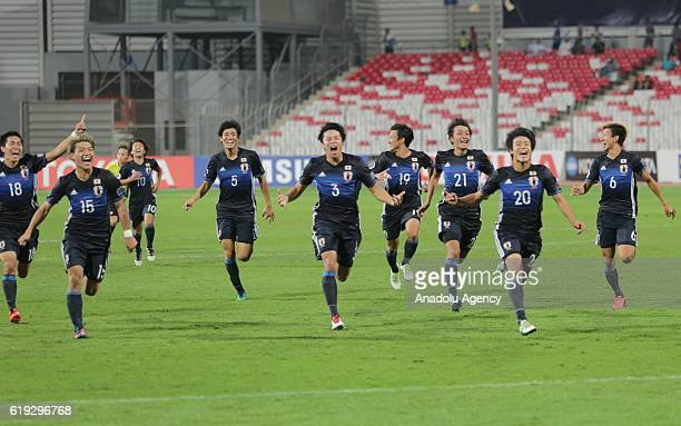 Football players of Japan celebrate the victory at the end of the Asian Under19 Championship football match between Japan and Saudi Arabia at the...