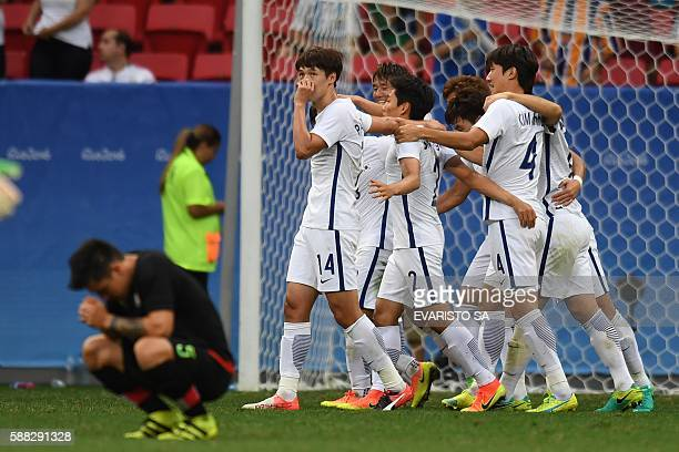 Football players of Korea Republic celebrate after winning their Rio 2016 Olympic Games first Round Group C men's football match Korea Republic vs...