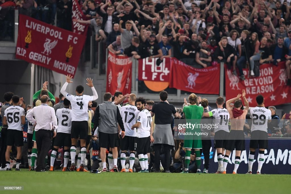Football players of Liverpool FC celebrate their victory at the end of the UEFA Champions League semi final return match between AS Roma and Liverpool FC at Stadio Olimpico on May 2, 2018 in Rome, Italy.