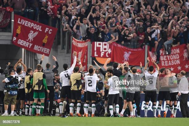 Football players of Liverpool FC celebrate their victory at the end of the UEFA Champions League semi final return match between AS Roma and...