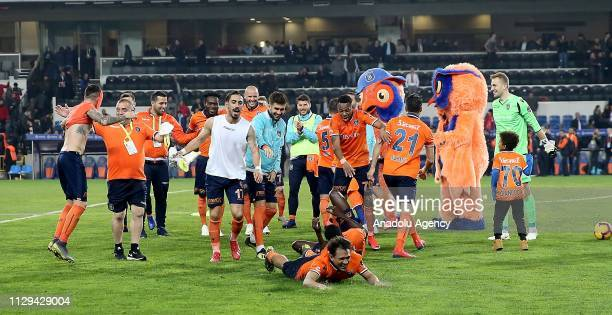 Football players of Medipol Basaksehir celebrate their victory at the end of the Turkish Super Lig soccer match between Medipol Basaksehir and...