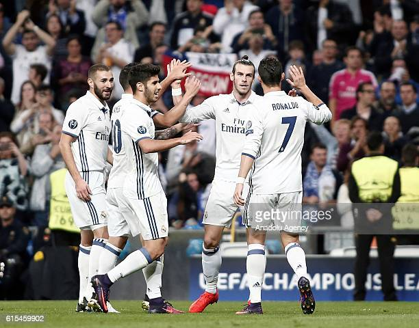 Football players of Real Madrid celebrate after scoring a goal during the UEFA Champions League Group F football match between Real Madrid and Legia...
