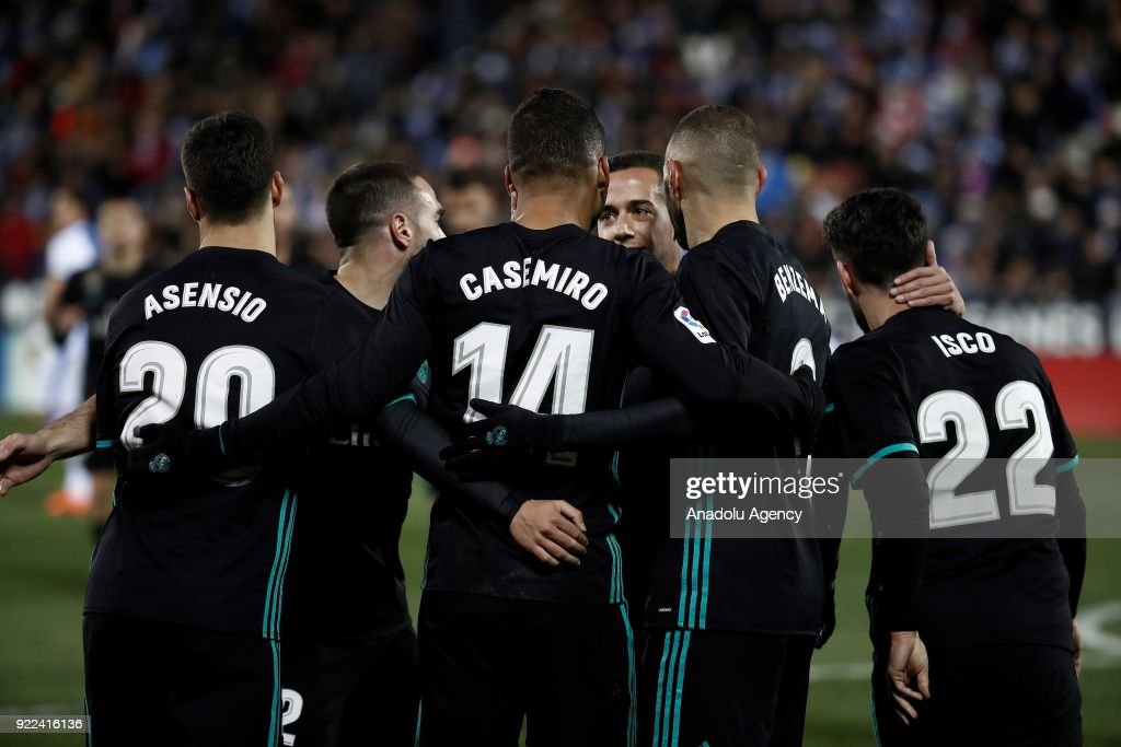 Football players of Real Madrid celebrate after scoring a goal during the La Liga football match between Leganes and Real Madrid at the Estadio Municipal Butarque in Madrid, Spain on February 21, 2018.