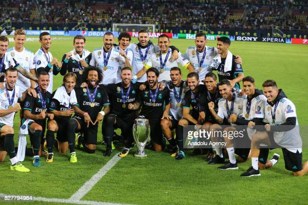 Football Players of Real Madrid pose for a photo with the trophy after their victory at the end of the UEFA Super Cup final between Real Madrid and...