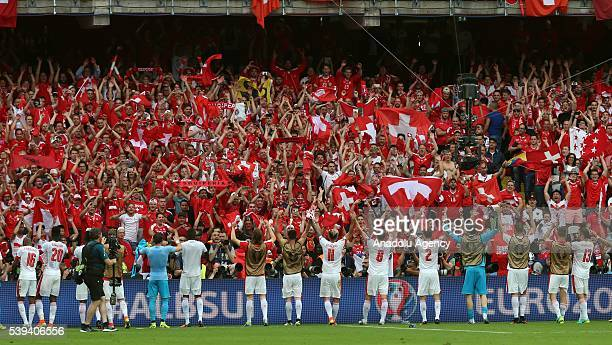 Football players of Switzerland celebrate their victory with their supporters at the end of the Euro 2016 group A football match between Albania and...