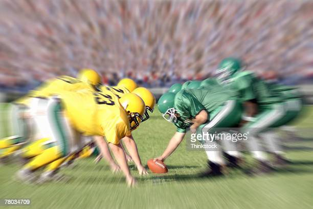 football players on the line of scrimmage during game - line of scrimmage stock pictures, royalty-free photos & images