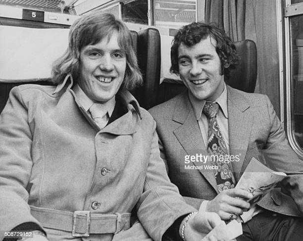 Football players Phil Parkes of Queens Park Rangers FC and Ray Kennedy of Arsenal FC on a train at Paddington Station with the rest of the England...
