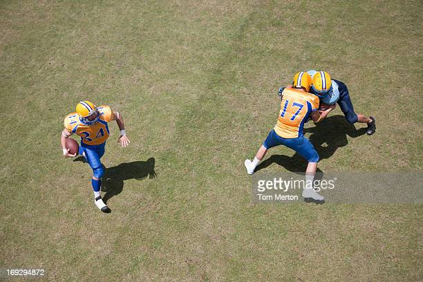 football players playing football - tackle american football player stock pictures, royalty-free photos & images