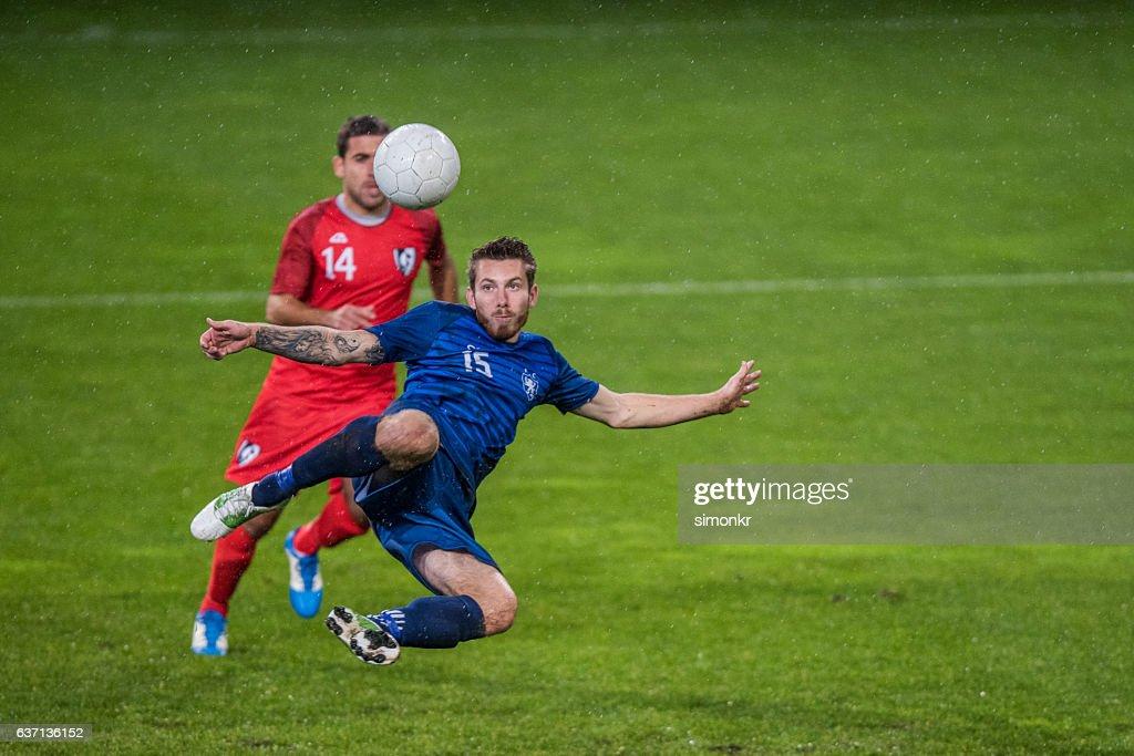 Football players playing football : Stock Photo