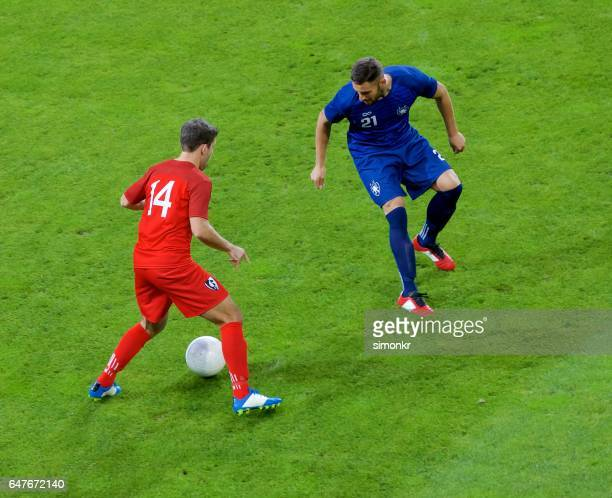 football players playing football - defender soccer player stock photos and pictures