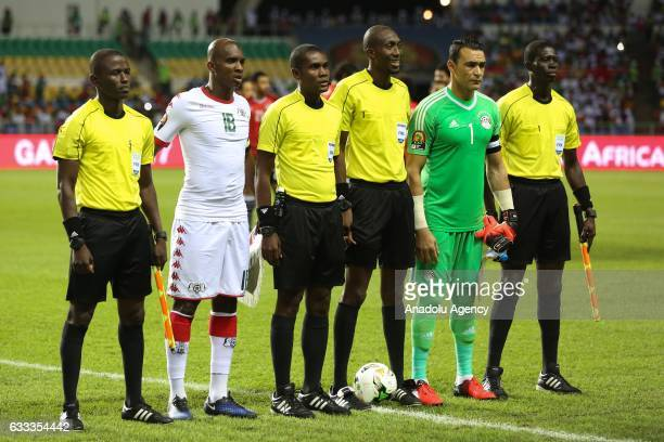 Football players pose for a photo with referees before the 2017 Africa Cup of Nations semifinal football match between Burkina Faso and Egypt at the...