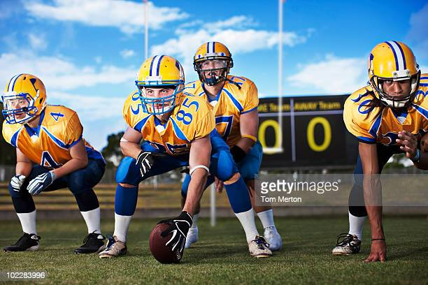 football players preparing to play football - quarterback stock photos and pictures