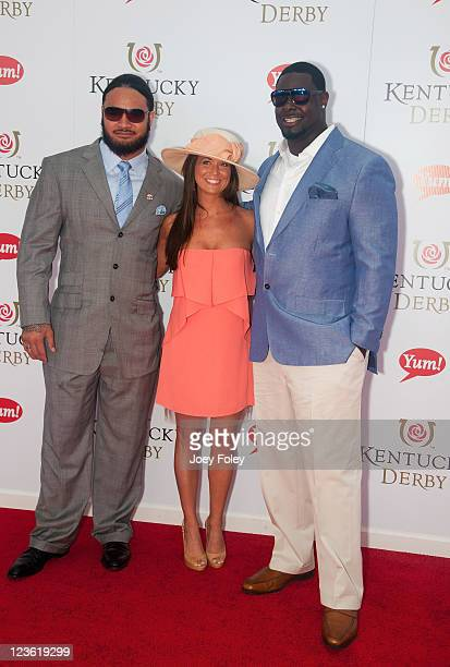 NFL football players Rey Maualuga and Frostee Rucker of the Cincinnati Bengals with guest attend the 137th Kentucky Derby at Churchill Downs on May 7...