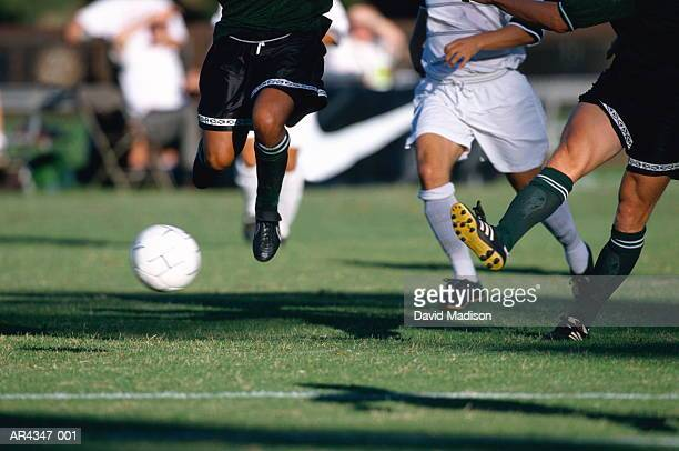 football players running for ball during game, close-up - tackling stock pictures, royalty-free photos & images