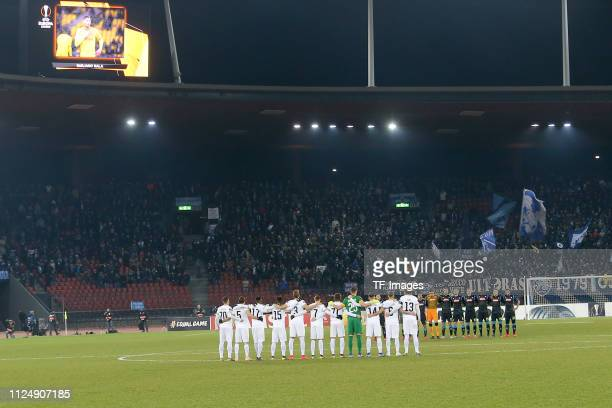 Football players stand in silence for Emiliano Sala before the UEFA Europa League Round of 32 First Leg match between FC Zurich and SSC Napoli at...
