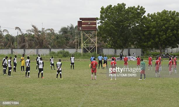 Football players stand in tribute to late Stephen Keshi during a football tournament organised by Bishop Mike Okonkwo at the national stadium in...