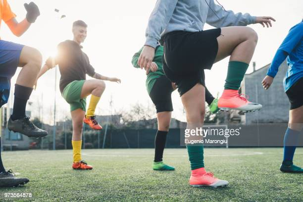 football players warming up before game - warming up stock pictures, royalty-free photos & images
