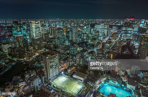 Football playground surrounded by buildings in Tokyo