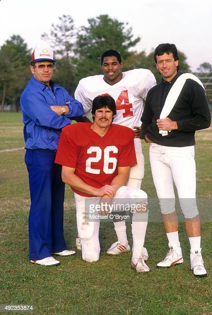 Portait of New Jersey Generals coach Walt Michaels with players Gary Barbaro Herschel Walker and Brian Sipe during training camp photo shoot at...