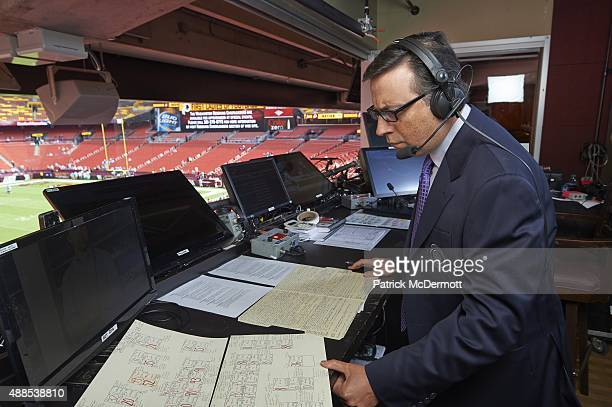 Portrait of CBS Sports announcer Ian Eagle with his crib sheets and game notes he recorded in preparation for the Washington Redskins vs Miami...