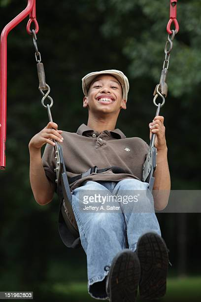 Portrait of Chancellor Lee Adams on a swing during photo shoot at his mother's gravesite in Sunset Memory Gardens Adams the son of former Carolina...