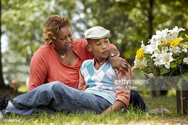 Portrait of Chancellor Lee Adams with his grandmother Saundra Adams during photo shoot at his mother's gravesite in Sunset Memory Gardens Adams the...