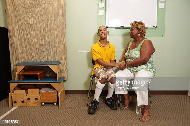 Portrait of Chancellor Lee Adams with his grandmother Saundra Adams during physical therapy Adams the son of former Carolina Panthers wide receiver...