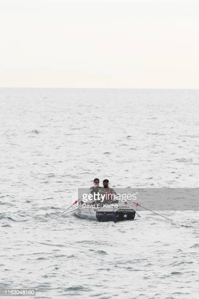 Portrait of former Chicago Bears defensive back Charles Tillman rowing a boat with Jake Beckley during photo shoot on Lake Michigan Tillman played 13...