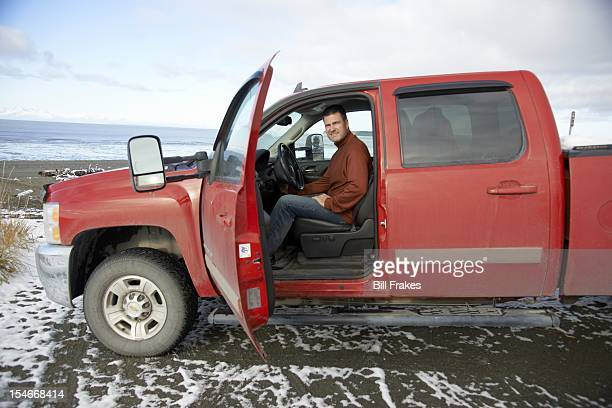 Portrait of former NFL kicker Jason Elam posing in his truck during photo shoot on Longmere Lake beach outside his home. Elam, a Florida native who...