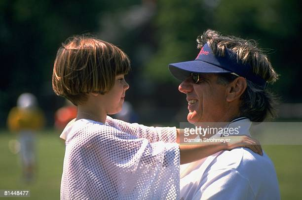Football Portrait of former QB Joe Namath with daughter Olivia at his football camp Hambden CT 7/1/1997
