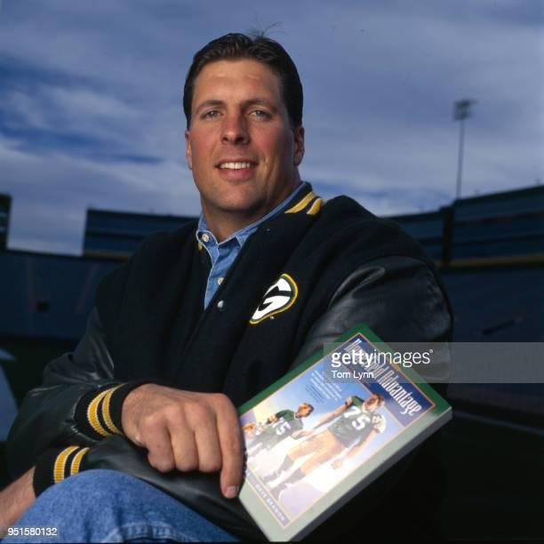 Portrait of Green Bay Packers Ken Ruettgers holding his book Home Field Advantage Green Bay WI CREDIT Tom Lynn