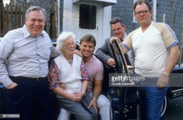 Portrait of Los Angeles Raiders Howie Long posing with his grandmother Elizabeth Hilton Mullan and uncles George John and Billy outside her home...