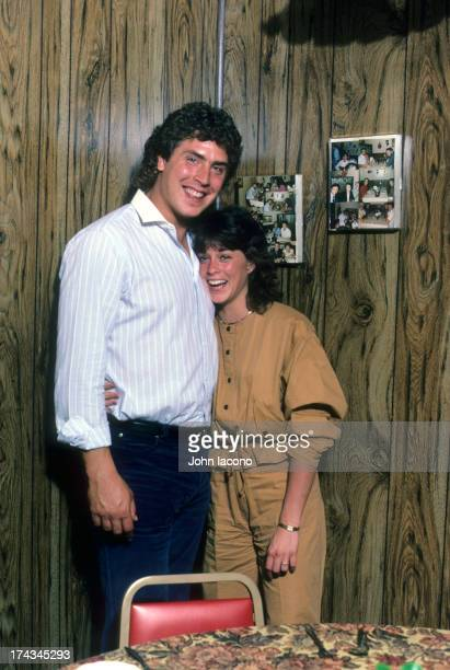 Portrait of Miami Dolphins QB Dan Marino posing with fiancee Claire Veasey during photo shoot at home Miami FL CREDIT John Iacono