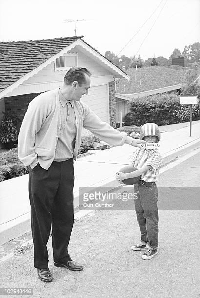 Portrait of Oakland Raiders coach Al Davis with son Mark at home Oakland CA 9/17/1963 CREDIT Curt Gunther
