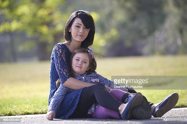 Portrait of Oakland Raiders fan Brittany Bryan with 4yearold daughter Lyla during photo shoot Bryan had survived a fall at Oco Coliseum Oakland CA...
