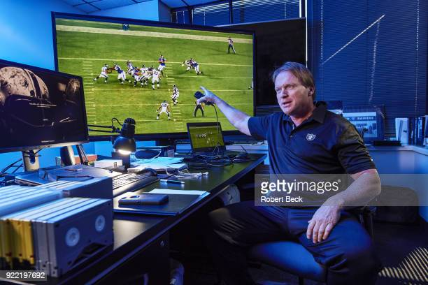 Portrait of Oakland Raiders head coach Jon Gruden reviewing film on video screen during photo shoot at team headquarters Alameda CA CREDIT Robert Beck