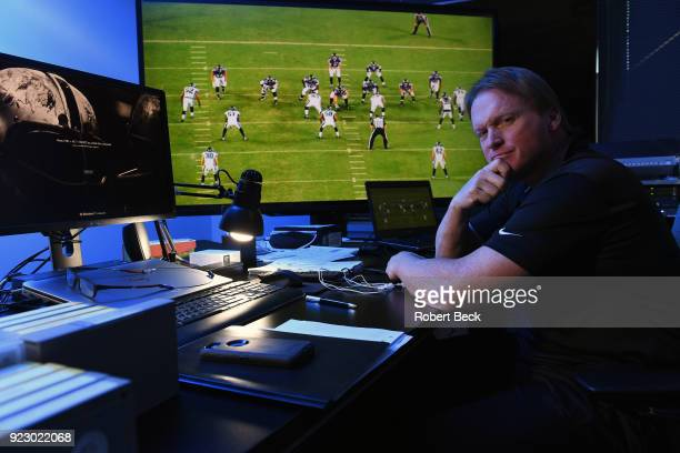 Portrait of Oakland Raiders head coach Jon Gruden watching tape in video room during photo shoot at team headquarters Alameda CA CREDIT Robert Beck