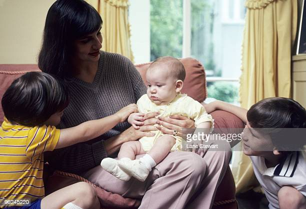 Portrait of Olivia Manning wife of New Orleans Saints QB Archie Manning with family Cooper Eli and Peyton during photo shoot at their Garden District...