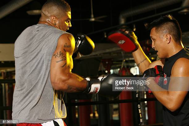 Football Portrait of San Diego Chargers Shawne Merriman in action demonstrating sparring exercise during workout at The Boxing Club La Jolla CA...
