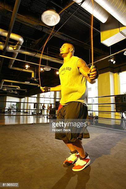 Football Portrait of San Diego Chargers Shawne Merriman in action demonstrating jumping rope exercise during workout at The Boxing Club La Jolla CA...