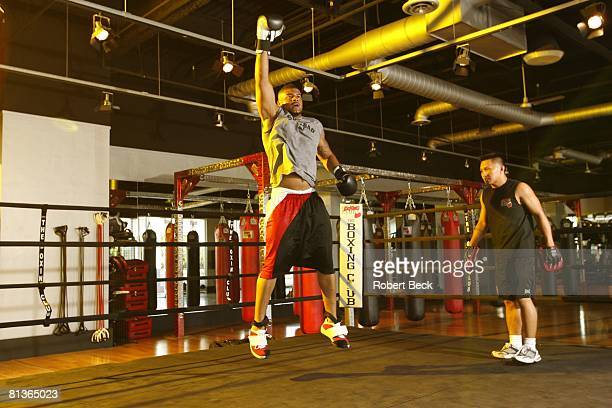 Football Portrait of San Diego Chargers Shawne Merriman in action demonstrating exercise during workout at The Boxing Club La Jolla CA 7/13/2006